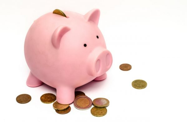 Piggy bank surrounded by coins