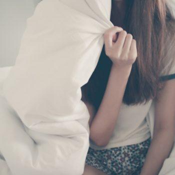 Girl under a duvet