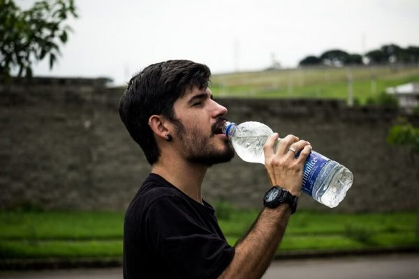 Man drinking from a bottle of water